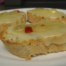 Crostini With Cheese Torta and Marinated Bell Peppers