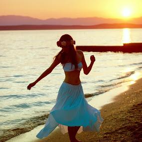Beautiful sunset by Tina Balgavi - People Portraits of Women ( dancing, orange, girl, blue, sunset, white, sea, dance,  )