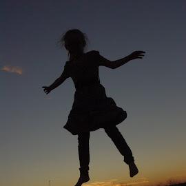 Sunset Flight by Jason Gaston - Babies & Children Children Candids ( female, fly, sunset, silhouette, jump )
