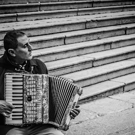 Some people have only music by Abhishek Shirali - People Musicians & Entertainers ( music, europe, b&w, musician, nikon, barcelona, spain,  )