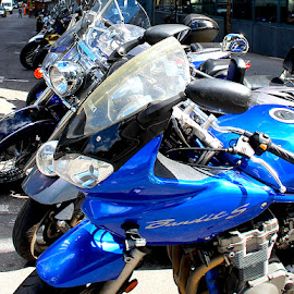Motorcycle Parking ONLY by Ronnie Caplan - Transportation Motorcycles ( motorcycles, kickstands, parking, windshields, streetscene, handlebars, lined up, downtown )