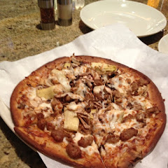 Gluten-free Italian sausage artichoke hearts, and mushroom pizza