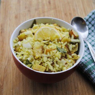 Batata poha recipe - Poha (rice flakes) with potatoes, onions and spices