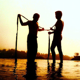 Summer of 69 by Shunno Ayon - Instagram & Mobile Instagram ( water, duels, reflection, nature, gay, silhouette, summer, lake, partner, people, river, golden light )
