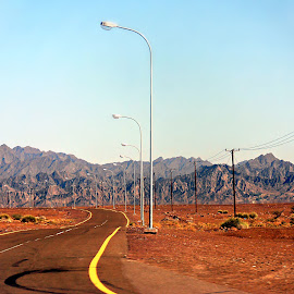 Desert Crossing 3 by Tamsin Carlisle - Landscapes Deserts ( mountains, desert, hajar, oman, lamp, posts, line, power, electricity, road, poles, transmission,  )