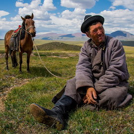 Ranger in Mongolia by John Park - People Portraits of Men ( herdsmen, blue sky, grassfield, horse, travel, landscape )