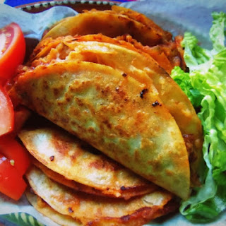 Tacos de Canasta Filled with Spicy Potatoes and Cheese
