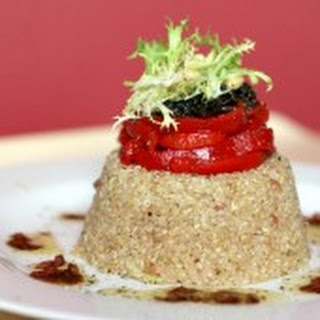 Quinoa with Piquillo Peppers, Cured Olives and Frisée – Served with a Balsamic–Shallot Vinaigrette