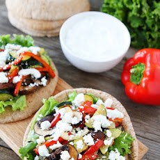 Healthy Pita Sandwich With Roasted Vegetables, Feta Cheese, And Tzatziki Sauce!