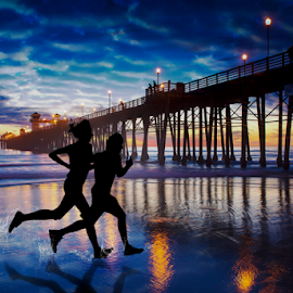 by Alan Crosthwaite - Digital Art People ( beach backgrounds, oceanside, jogging, beach sunsets, southern california, fitness, oceanside pier, pier backgrounds, tourism, travel, running, coastal, silhouetted, destination, san diego, piers, sunset, travel backgrounds, friendship, silhouettes, pier, pier sunsets, runners )