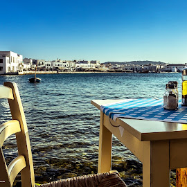 Dinner's ready…just waiting for you. by Pedro Silva - City,  Street & Park  Street Scenes ( olive oil, dinner, peper, mykonos, waterscape, greece, sea, pedrosilvaimages, table, boat, pedro silva, salt )