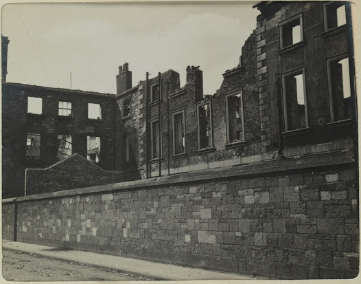 Linen Hall Barracks, home to the British Army Pay Corps, was occupied by Irish Volunteers and set alight as a disruption during the Rising. The remaining buildings were later demolished