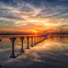 Still Waters by Etta Cox - Instagram & Mobile iPhone ( #sunrise #reflection #water #sun # pier #clouds )