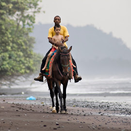 Riding down the beach by Barbara Sajnog - Transportation Other ( child, ahorse, cameroon, horse, couple, beach, africa, seme beach, tropics )