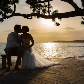 Sunset Kiss by Caitlin Lisa - Wedding Bride & Groom ( kiss, jamaica, sunset, wedding, bride and groom, beach wedding )