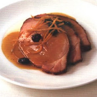 Smoked Loin of Pork with Citrus, Rum and Raisin Sauce