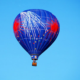 Blue hot air balloon, with fireworks on it. by Walter Carlson - Transportation Other ( hot air balloon, red, blue, albuquerque, fireworks, new mexico )
