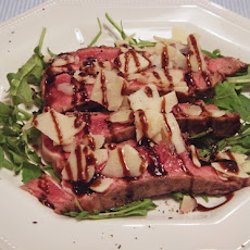 Grilled Steak on a Rocket Bead with Parmesan Shavings and Balsamic Glaze