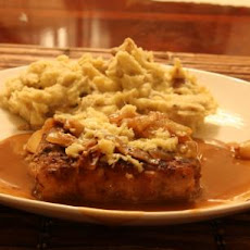 Pork Chops With Caramelized Onions and Smoked Gouda