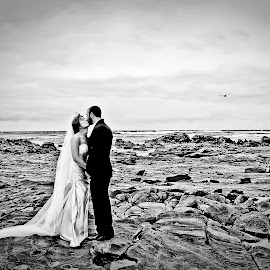 Great Ocean Road by Alan Evans - Wedding Bride & Groom ( great ocean road, wedding photography, kissing, lovers, black and white, lorne, aj photography, lorne wedding photographer, ocean, great ocean road wedding photographer, kiss, wedding, wedding day, couple, bride and groom, bride, groom, rocks, bride groom )