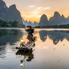Fisherman at river Li by Shalabh Sharma - People Professional People