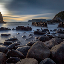 Tranquil by Rio Tanusudiro - Landscapes Beaches ( coral, afternoon, mood, cloudy, long exposure, beach, motion, rocks )