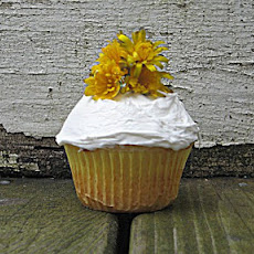 Lemon Poppy Seed Cupcakes Topped With Lemon Buttercream Frosting