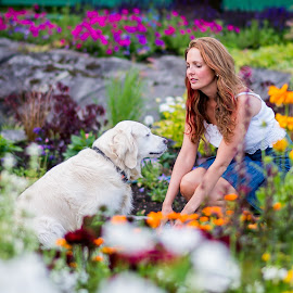 Heidi and Sasha by Jørn Lavoll - Animals - Dogs Playing ( colorful, woman, flowers, dog, golden retriever )