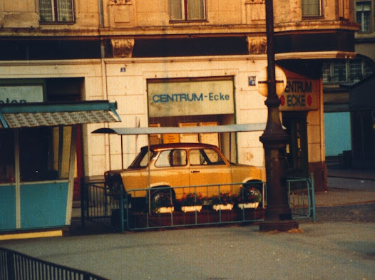 Trabant car offered as lottery prize outside East Berlin 'supermarket'