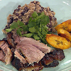 Puerto Rican-Style Roasted Pork Shoulder with Rice and Black Beans and Fried Sweet Plantains