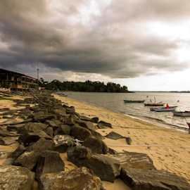 The retaining wall. by Victor Sim - Landscapes Beaches ( boats, beach, landscape, rocks )