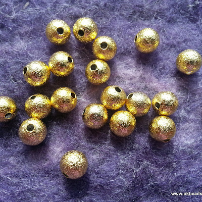 6mm Gold Stardust beads x30