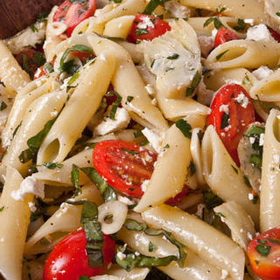 Cold Pasta Salad with Baby Artichokes (Pinninos kin Iscarzofa)