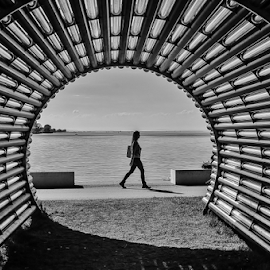 Gun Street Girl! by Jesus Giraldo - City,  Street & Park  Street Scenes ( sculpture, concept, girl, art, lake, beauty, walk, shadows, black&white, tunnel )
