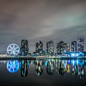 Melbourne Docklands Reflections by Zubair Aslam - City,  Street & Park  Night ( melbourne, reflections, long exposure, docklands, melbourne star, nightscape, , city at night, street at night, park at night, nightlife, night life, nighttime in the city )