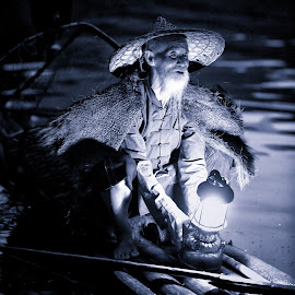 Fisherman prepare to work, Yangshuo by Dharmali Kusumadi - People Portraits of Men