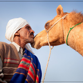 Affection by Nayyer Reza - People Portraits of Men ( pakistan, camel, color, friendship, pals, buddies, nayyer, reza )