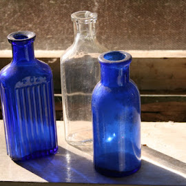 Bottles in Window by Waynette  Townsend - Artistic Objects Glass ( window, blue glass, glass, bottles, antique, light,  )