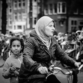 Cycling by by Jamie Brown - People Street & Candids ( jacket, girl, bike, street, amsterdam, young, asian, eyes )