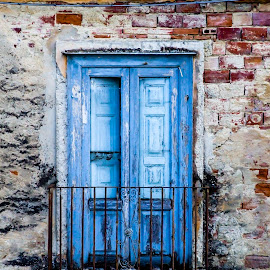The blue door by Marcello Saladino - Buildings & Architecture Homes ( two_tone, old, red, metal, blue, brick, door, balcony,  )