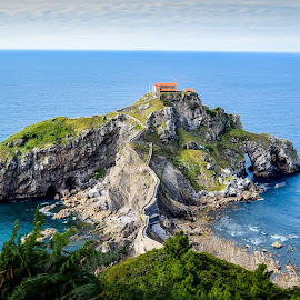 San Juan de Gaztelugatxe by Justin Murazzo - Landscapes Travel ( europe, bilbao, rocky, stone, ocean, north, beach, long, gaztelugatxe, spain, coast, miniature, stairs, bay of biscay, tide, walkway, rocks, juan, look, water, ring, edge, biscay, church, grass, waves, green, cliff, steep, sea, northern spain, bakio, steps, trek, bell, basque country, san, effect, bay, blue, color, cantabrian, down, walk, green coast, hike, san juan de gaztelugatxe )