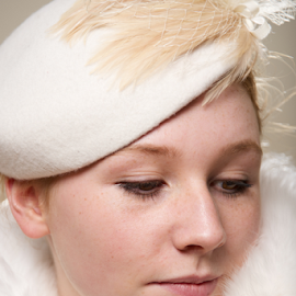 Close-up of redhead in white feathered hat by Nick Dale - People Fashion ( girl, woman, white, fur, redhead, beret, freckles, portrait, close-up, hat )