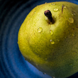 A pear by David Stone - Food & Drink Fruits & Vegetables ( bowl, fruit, water drops, still life, poir, pottery, pear,  )
