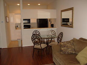 Living area, dining area, and kitchen from entry view