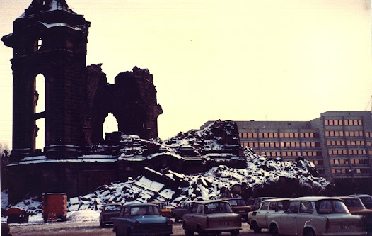 The ruins of the Frauenkirche in Dresden, destroyed in the Allied firestorm of February 1945, with a line of Trabants and a new hotel. In 1982, I accidentally fuelled a demonstration by young 'peaceniks' here by reporting what was only a rumour amongst dissidents in East Berlin but became reality after my report was repeated by West German television, watched by most East German citizens. As a result several hundred gathered at the site to be heavily monitored by police and Stasi.