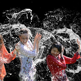 Girls in splash by Hendrik Cuaca - People Street & Candids