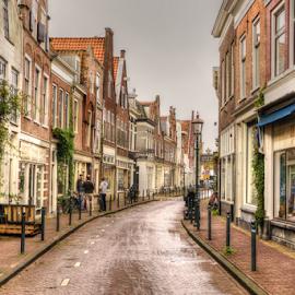 A Street in Haarlem by Uri Baruch - City,  Street & Park  Neighborhoods ( doors, sky, window, shops, holland, street, roofs, the netherlands, windows, poeple )