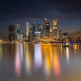 Singapore CBD at Night by Kristianus Setyawan - City,  Street & Park  Night ( skyline, reflection, water reflection, city scene, waterscape, cityscape, landscape, singapore, marina bay, city, city that never sleeps, reservoir, city view, city lights, landscape photography, skyscape )