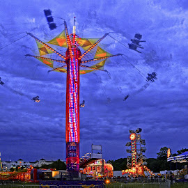 The Swing by Jeff Stallard - City,  Street & Park  Amusement Parks ( ride, amusement park, carnival, twilight, swing, midway )