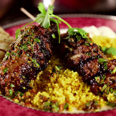 Moroccan Beef Kebabs with Curried Couscous, Raita and Charmoula Vinaigrette